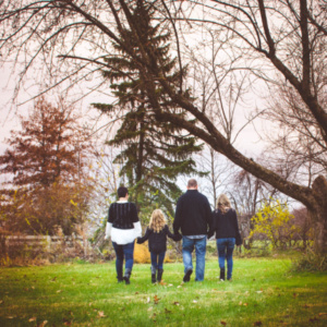family of four walking away