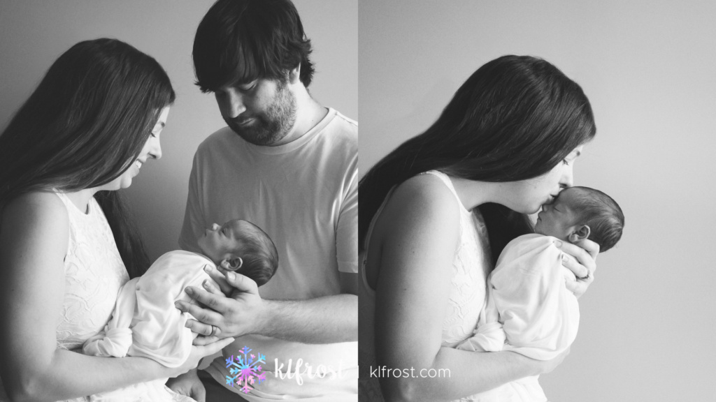 family of three kissing on their newborn child in black and white