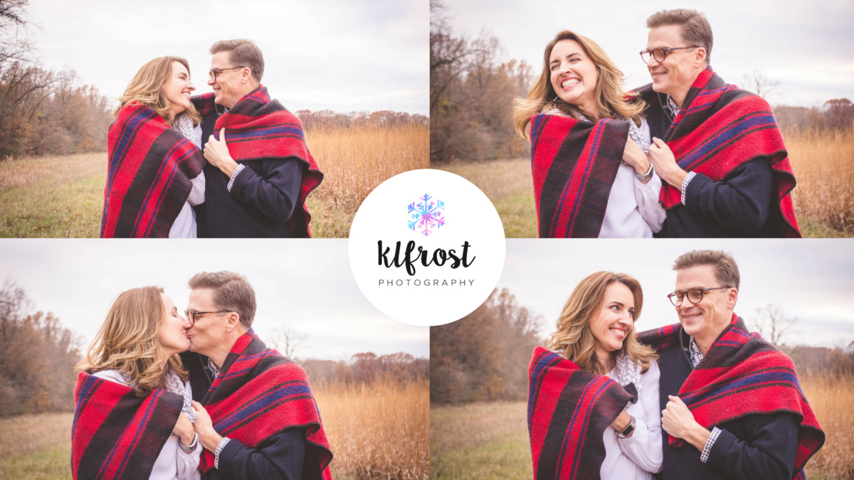 man and woman couple with red flanal blanket wrapped around shoulders laughing