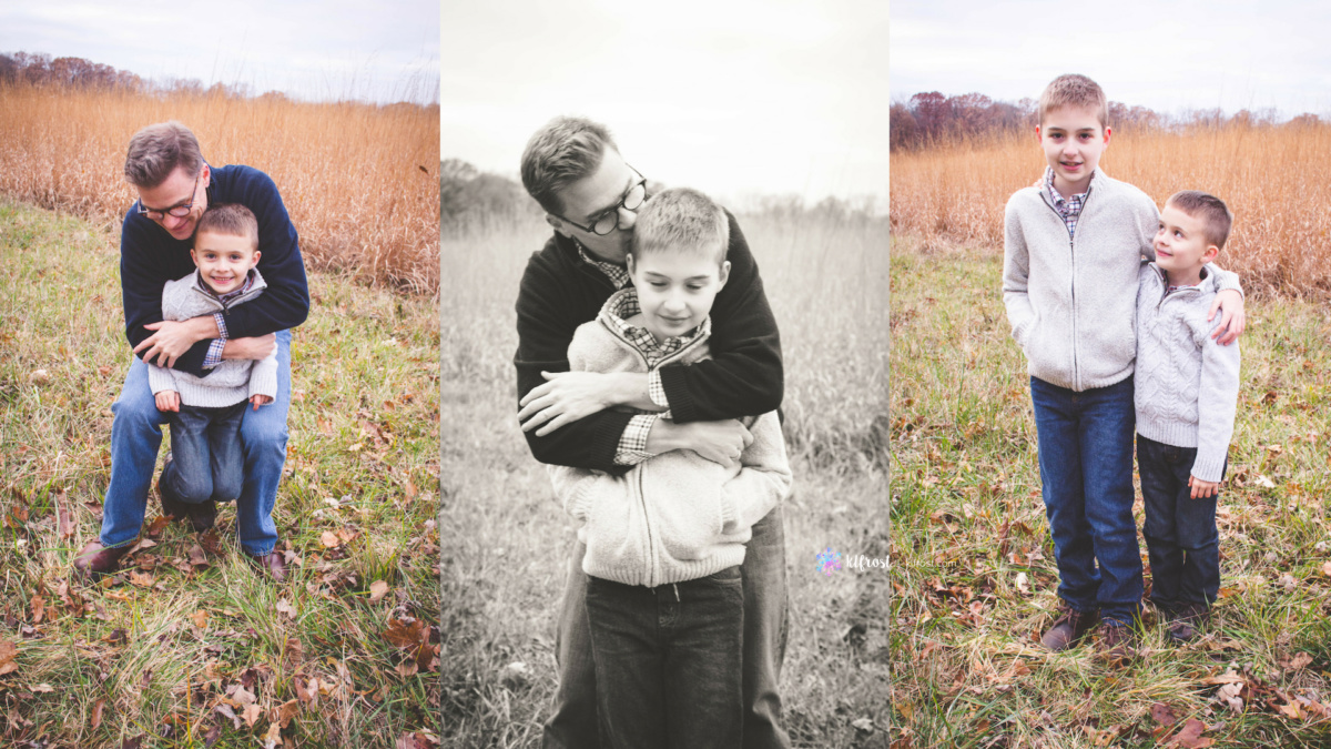 dad and sons wearing sweaters and jeans in field
