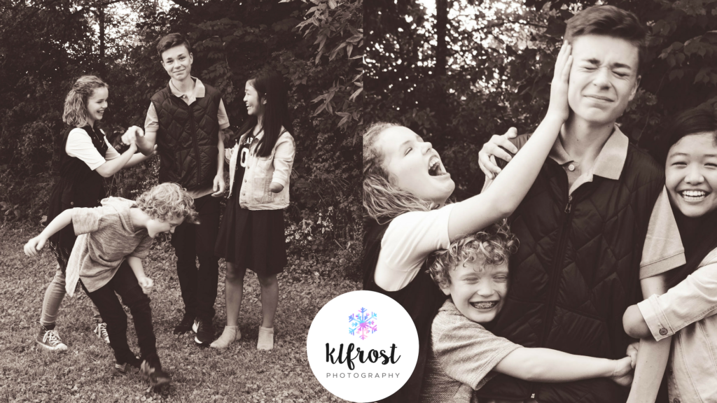 4 siblings playing and being silly in black and white