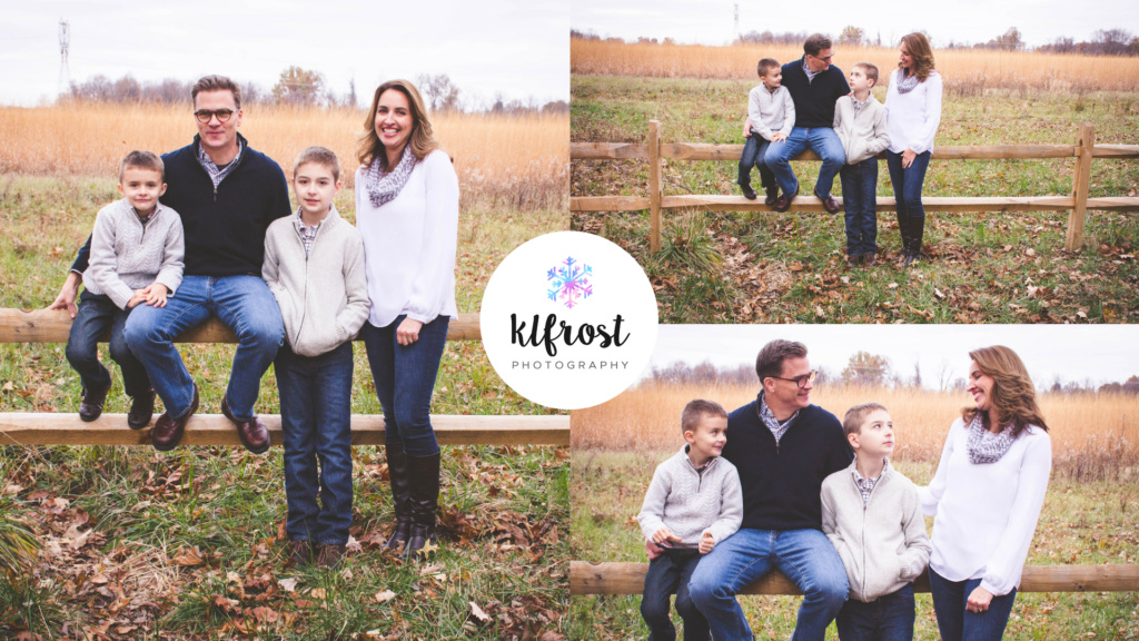 family of 4 sitting on fence line in field