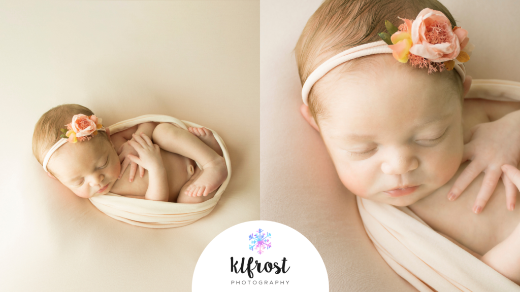 newborn baby girl laying on sofe peach fabric wrapped in peach wrap with flower headband