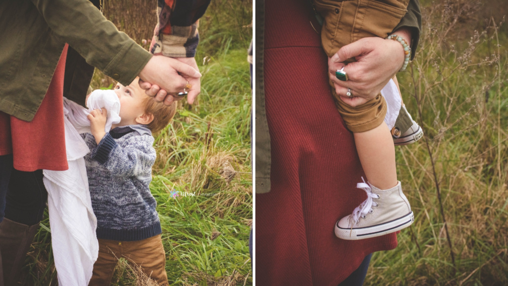 mom holding dads hand while son wants picked up then mom embraing son in arms