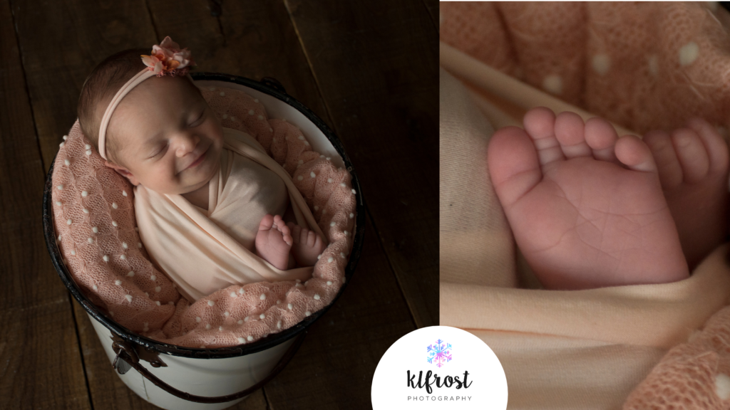 baby girl wrapped in peach fabric inside white bucket with toes poking out and smiling