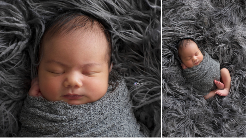 newborn baby wrapped in grey cloth with hand on cheek asleep