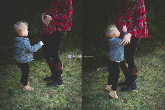 little boy kissing mommas pregnant belly in forest